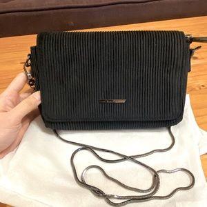 Black crossbody bag with metal strap